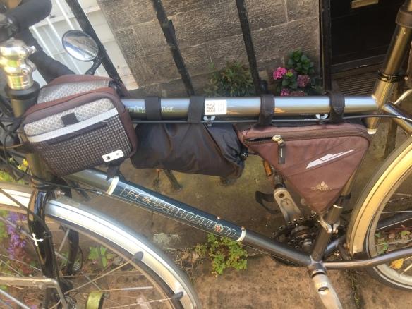 My bike carrying a raincoat